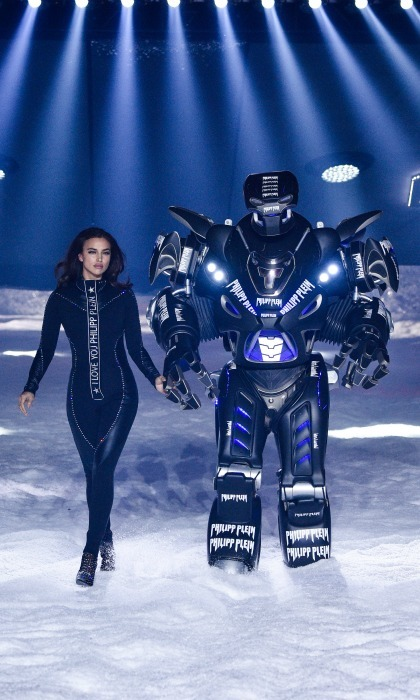 Mr. Roboto! The Philipp Plein show in NYC opened like a science fiction movie: Irina Shayk made her way down the runway while holding hands with a robot as snow fell around them. The 32-year-old model flaunted a fabulous figure in a form-fitting suit, during the ski-inspired show at the Brooklyn Navy Yard.