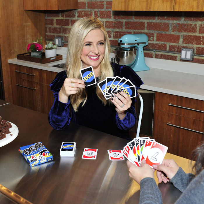 Sarah Michelle Gellar, who is a mom of two, indulged in some playtime checking out the new DOS from the makers of UNO.