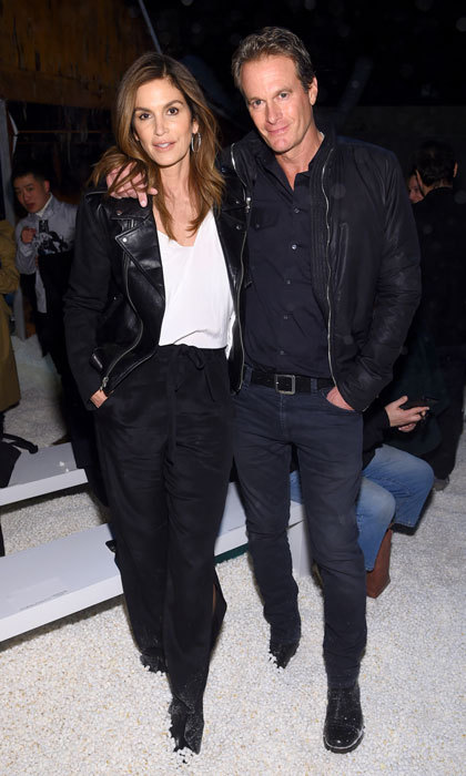 Proud parents Cindy Crawford and Rande Gerber were a stylish duo as they watched their daughter Kaia take on the catwalk during the Calvin Klein show.