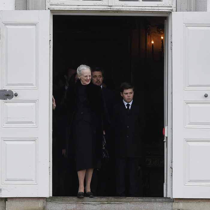 A widowed Queen Margrethe emerged from Fredensborg Palace on February 15, as the hearse carrying her husband's remains prepared to leave for Amalienborg Palace. 
