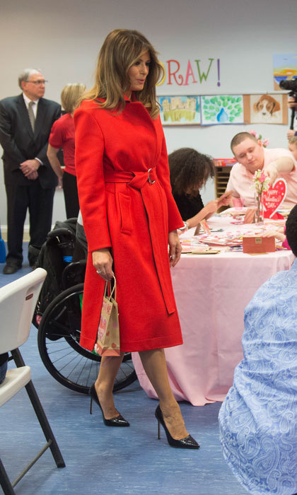 The First Lady of the United States was dressed for the occasion during her Valentine's Day visit to the Children's Inn in Bethesda, Maryland. Mrs. Trump wore a red coat by Calvin Klein (which retails at $798) with her signature pumps.