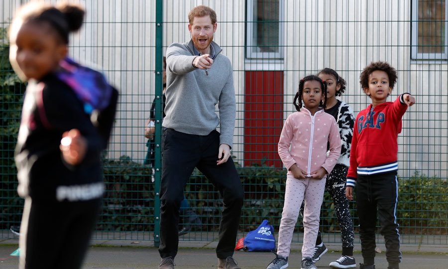 Game on! After handing out lunches, Prince Harry met children playing outside in the games area where he participated in a round of Simon Says. 