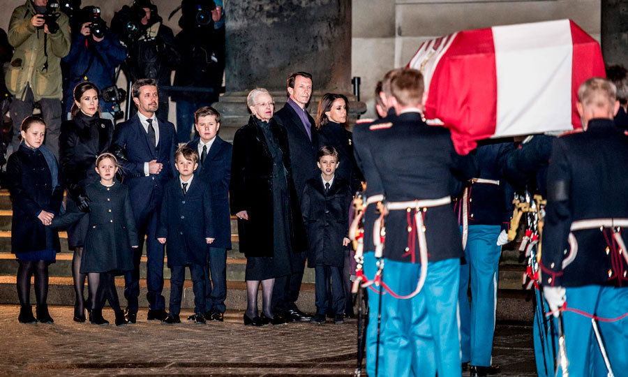 Ahead of the public being able to go pay their respects to Prince Henrik and his family, the Danish royals gathered as they brought his coffin into Castrum Doloris in Christiansborg Palace Church on February 16. Dressed in black, Crown Prince Frederik and Prince Joachim, along with their respective wives — Crown Princess Mary and Princess Marie — and children, stood on either side of their mother Queen Margrethe II.