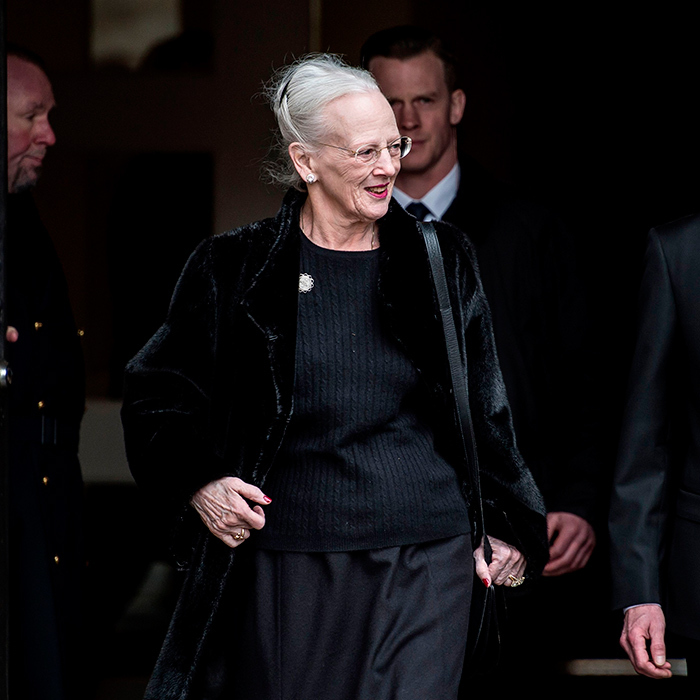 The widowed Queen, dressed in a simple black sweater, was seen leaving Christiansborg Palace Church where her husband will remain until he is laid to rest on February 20.