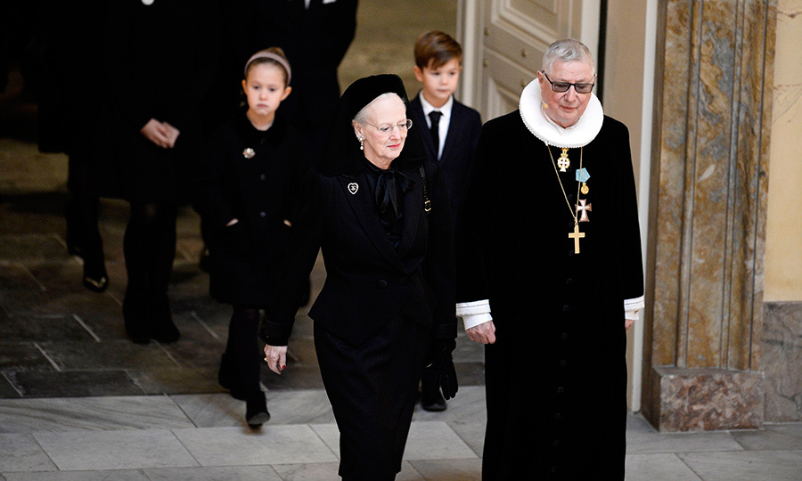 Prince Henrik's widow Queen Margrethe of Denmark had been accompanied into the Christiansborg castle church by royal confessor Erik Norman Svendsen for the funeral service.  