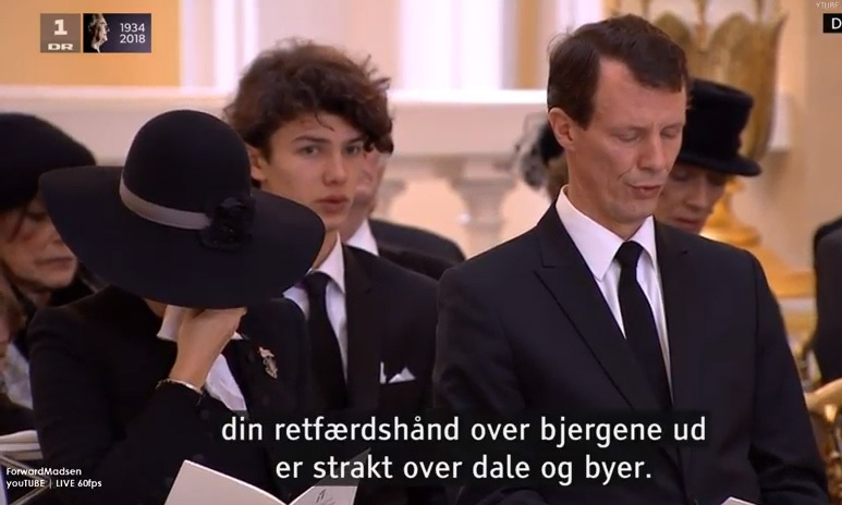 Princess Marie, seated alongside Prince Joachim and in front of stepson Prince Nikolai, who had just returned from modeling for Burberry in London, also became understandably emotional during the service, and was spotted wiping tears from her eyes.