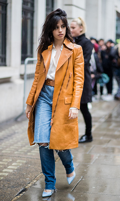 Camila Cabello was a bit more casual in ripped boyfriend jeans, a leather trench and blue high heels as she strolled the rainy streets of the city. 