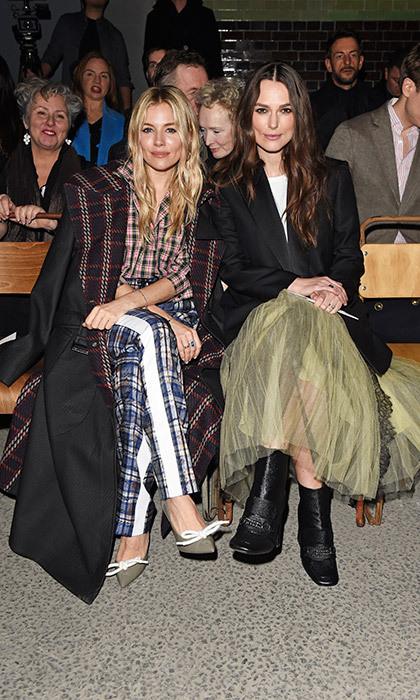 Two very stylish British stars, Sienna Miller and Keira Knightley, sat next to each other in the FROW at Burberry. 
