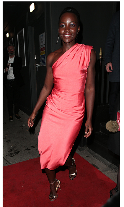 <i>Black Panther</I> star Lupita Nyong'o wore a bright one-shouldered dress to a party at MNKY HSE, a Latin American restaurant in Mayfair. 
