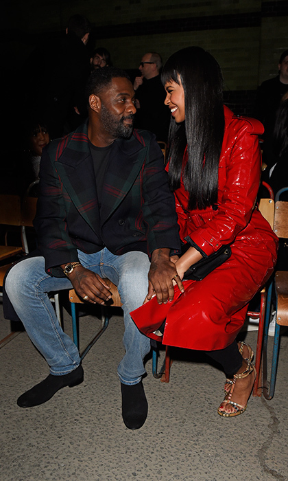 Idris Elba and his new fiancée Sabrina Dhowre were totally loved up at the star-studded Burberry show on February 17. 