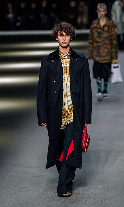 Meanwhile, 18-year-old Danish Prince Nikolai made his debut on the Burberry runway, showing off a dark military style coat, silk shirt and leather bag.