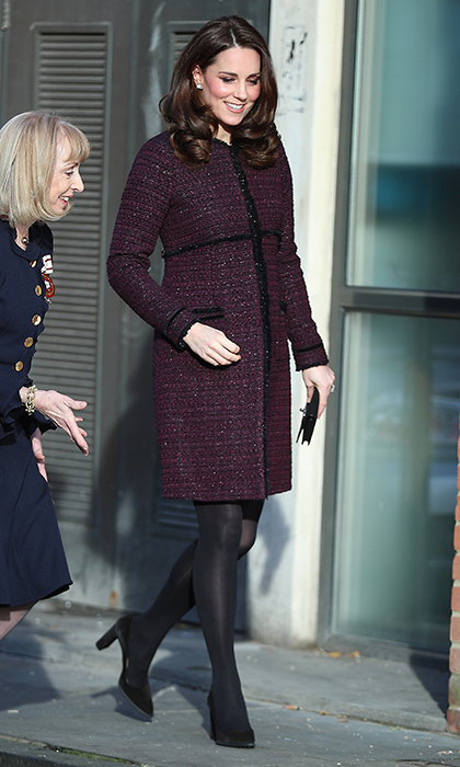 While expecting her third child, the Duchess of Cambridge re-wore the 'Marina' maternity coat that had first been seen while she was pregnant with Princess Charlotte back in 2014. She's wearing the coat here in December 2017 to the 'Magic Mums' community Christmas party held at Rugby Portobello Trust.  Photo: Getty Images