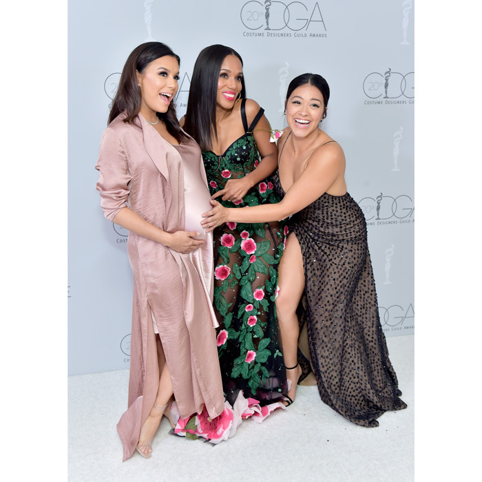 Pregnant Eva Longoria, Kerry Washington and Gina Rodriguez hammed it up on the carpet during the 20th annual Costume Designers Guild Awards in Beverly Hills.
