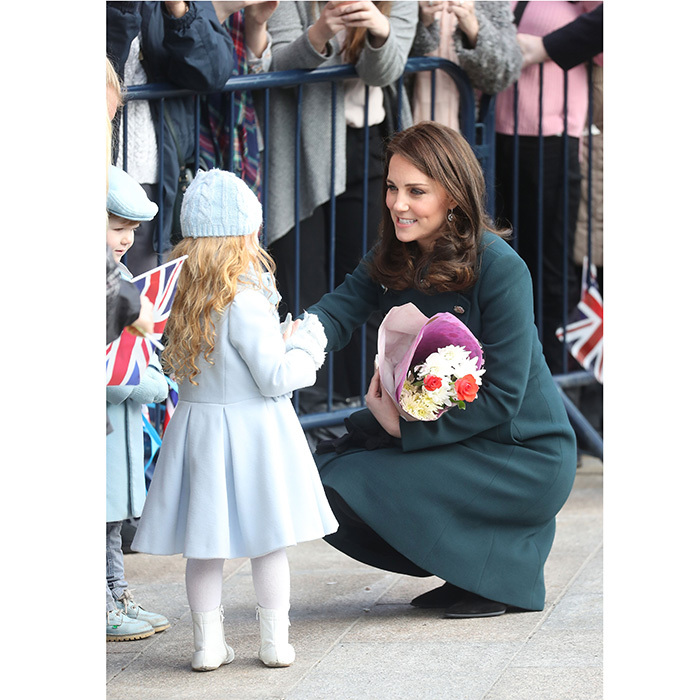 Royals may be used to seeing people curtsy but it was the Duchess of Cambridge who found herself on bended knee as she chatted with a cute little girl during the royal visit to Sunderland, England.