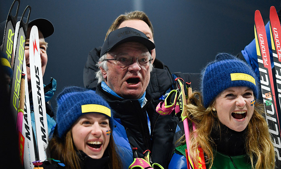 Swedish King Carl Gustaf celebrated with Anna Magnusson, left, and Mona Brorsson after they won the silver medal in the women's 4x6km biathlon event during the Pyeongchang 2018 Winter Olympic Games.