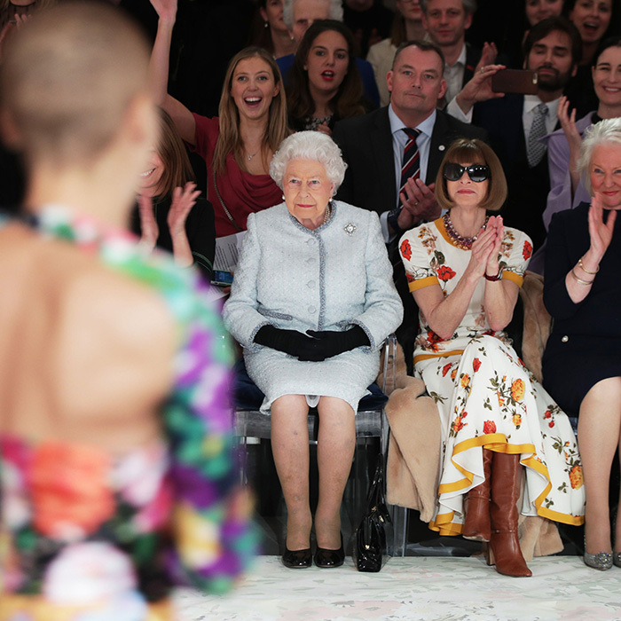 Queen Elizabeth II took a seat in the front row at London Fashion Week for the first time! The monarch, who absolutely stunned hard-to-impress fashionistas with her visit, was accompanied by <I>Vogue</I> editor Anna Wintour to view British designer Richard Quinn's runway show.