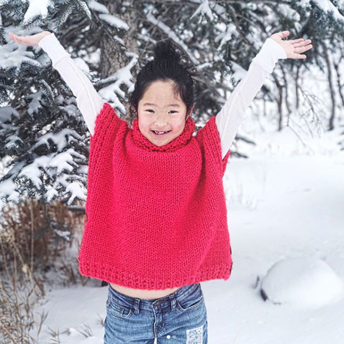 Katherine Heigl had the cutest model to show off her latest creation. The avid knitter had oldest daughter Naleigh test out her red poncho in the Utah snow. 
