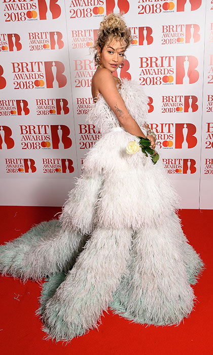 We spy another white rose! Rita Ora stunned in an opulent strapless feathered dress at the BRIT awards red carpet.