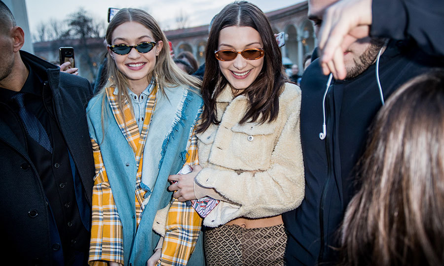 Model siblings Gigi and Bella Hadid were all smiles and wearing 1970s prints outside Alberta Ferretti.
