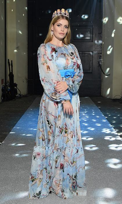 A day earlier Lady Kitty took the catwalk for the fashion house's Secret & Diamond show wearing a long sleeved silk gown with a cherub print.