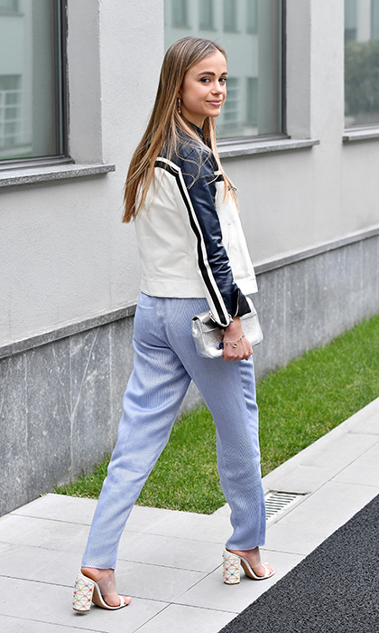 "Meanwhile, Lady Amelia Windsor, once named by <I>Tatler</I> as the ""most beautiful member of the royal family"" wore blue trousers and a motorcycle jacket to the Emporio Armani show.