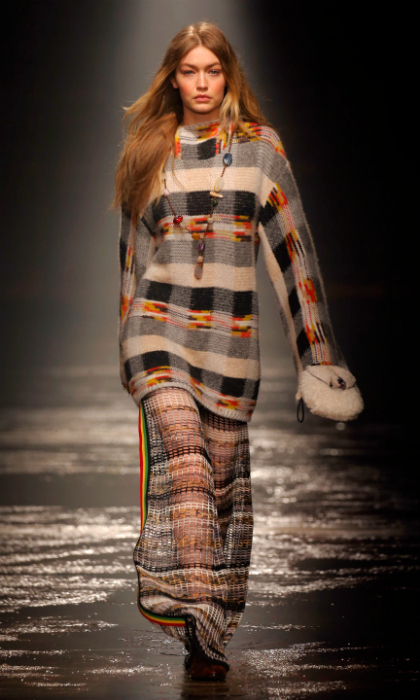 Gigi Hadid waltzed down the runway at the Missoni show during Milan Fashion Week Fall/Winter 2018/19 on February 24 in Milan, Italy. The 22-year-old model opened the event in a plaid sweater dress with flowing, matching knit pants.