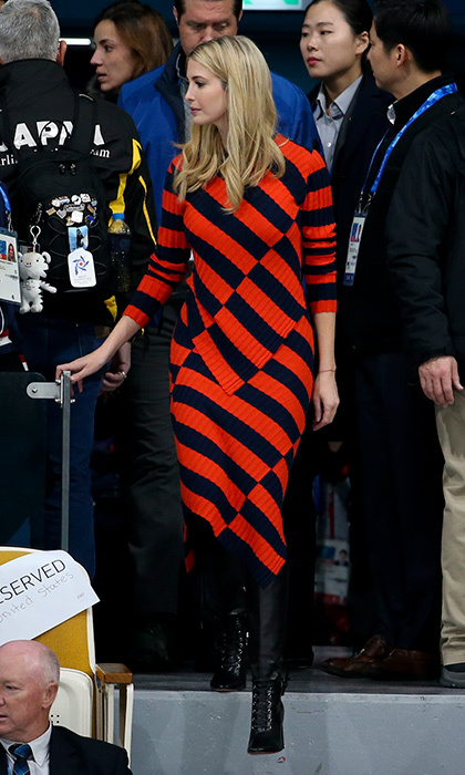 To check out the Curling Men's Gold Medal Game between USA at the PyeongChang 2018 Winter Olympic Games on February 24, Ivanka swapped her sporty gear for a red and black graphic knit dress and high-heeled booties. 