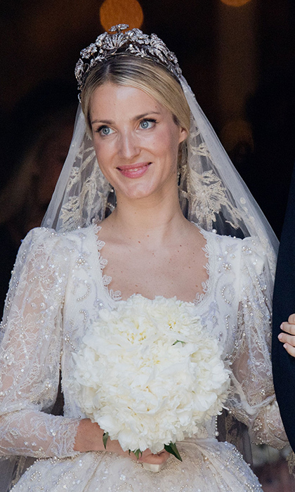 The Prince's bride Ekaterina, a London-based fashion designer, was picture-perfect in a custom hand-embroidered Chantilly lace gown with pearl detail by Lebanese designer Sandra Mansour. Anchoring her stunning veil was a tiara worn by Princess Victoria Louise for her marriage to the groom's great-grandfather Ernst August III.