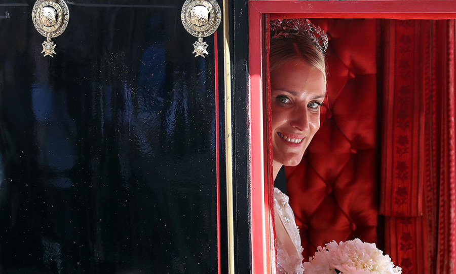 Ekaterina looked every inch a fairytale princess bride as she peeked out at wellwishers.