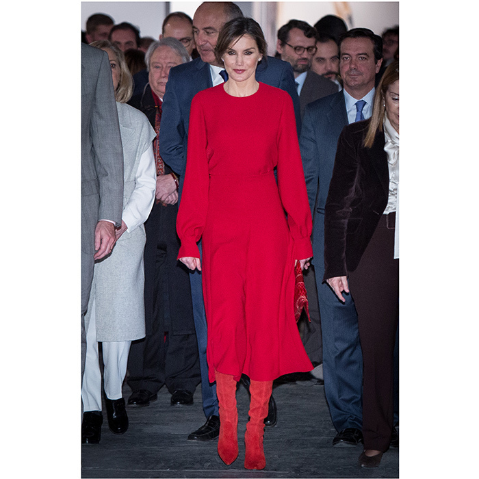 Spain's Queen Letizia isn't one to shy away from bold color – and she definitely stood out from the crowd in her bright red ensemble at the opening of the ARCO 2018 Contemporary Art Fair in Madrid. The Queen's snakeskin clutch is by Carolina Herrera, and her red suede boots are from one of her fave shoe brands, Magrit.