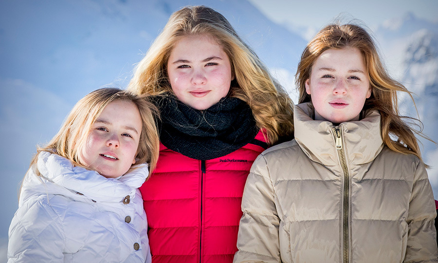 King Willem-Alexander and Queen Maxima's daughters –Princesses Ariane, ten, Amalia, 14, and Alexia, 12 – posed for this sisterly portrait during the royal family's annual winter photo call in Lech, Austria, on February 26.