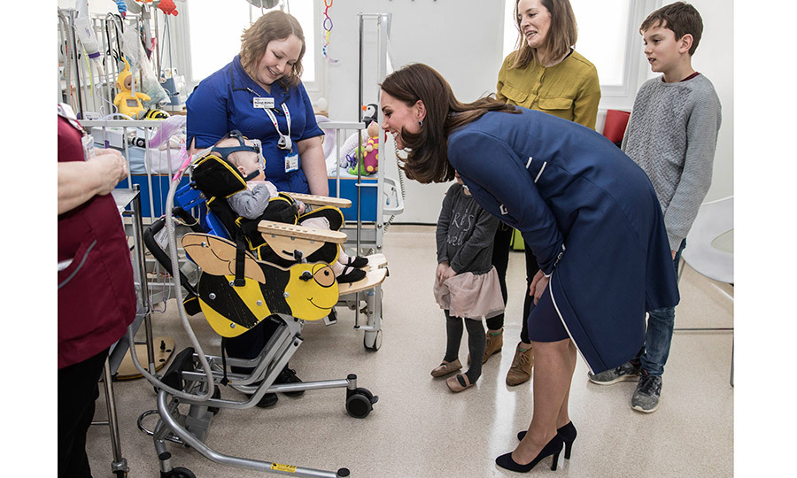 Kate Middleton had a big smile for this sweet little patient, ten-month-old Amara Kedwell-Parsons, who was born prematurely, during a visit to the children's Snow Leopard ward at St Thomas' Hospital in London on February 27.