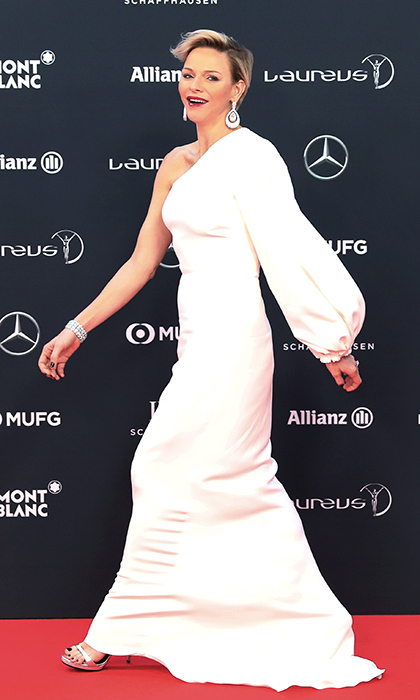 Princess Charlene of Monaco looked amazing in a white one-sleeved gown, silver sandals and heaps of diamonds as she stepped out for the Laureus 2018 awards in Monte Carlo on February 27.