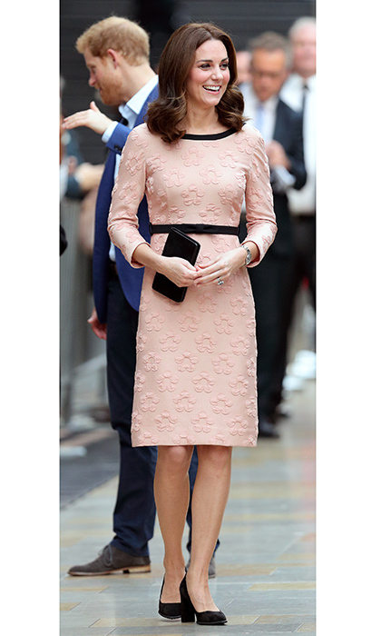 In October 2017, Duchess Kate, in the early stages of her third pregnancy, was pretty in pink in an Orla Kiely dress for a surprise appearance at London's Paddington train station to meet the cast and crew of <I> Paddington 2</I>. 