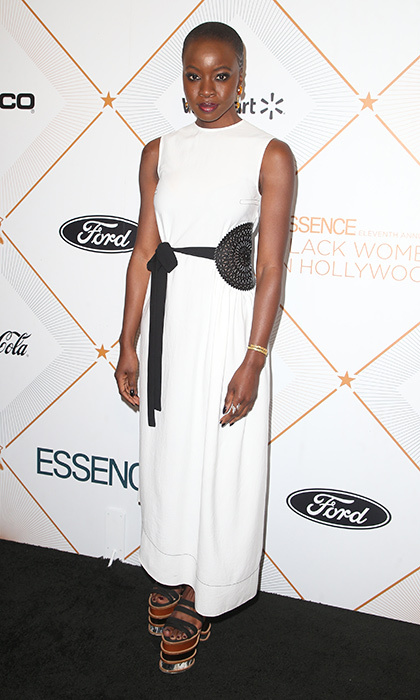 One of the luncheon's honorees, <I>Black Panther</I>'s Danai Gurira, was standing tall in amazing platforms and a white maxidress.