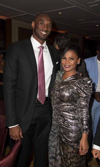 Also at the party was Oscar nominee Kobe Bryant who was mingling with guests including, here, actress Nia Long.