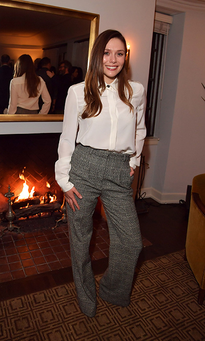 Elizabeth Olsen looked cozy in tweed trousers and a simple blouse in the penthouse at the Gersh get together.