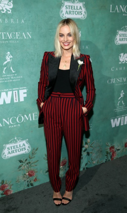 Pretty in pinstripes! Margot Robbie stepped out for the event in a sleek red and black number. The <i>I,Tonya</i> star kept her blonde tresses down for a casual touch.