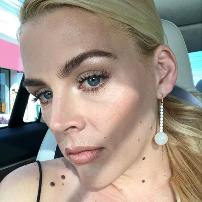 """Just really into this eyebrow, earring, low ponytail combo,"" posted Busy Philipps as she captured her look for posterity.