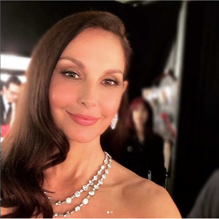 "Actress and Time's Up activist Ashley Judd shared a selfie before taking the Oscars stage, captioning the photo ""Preparing to present at the #Oscars with @salmahayek and @iamannabellasciorra. #Oscars90 #TimesUp.""