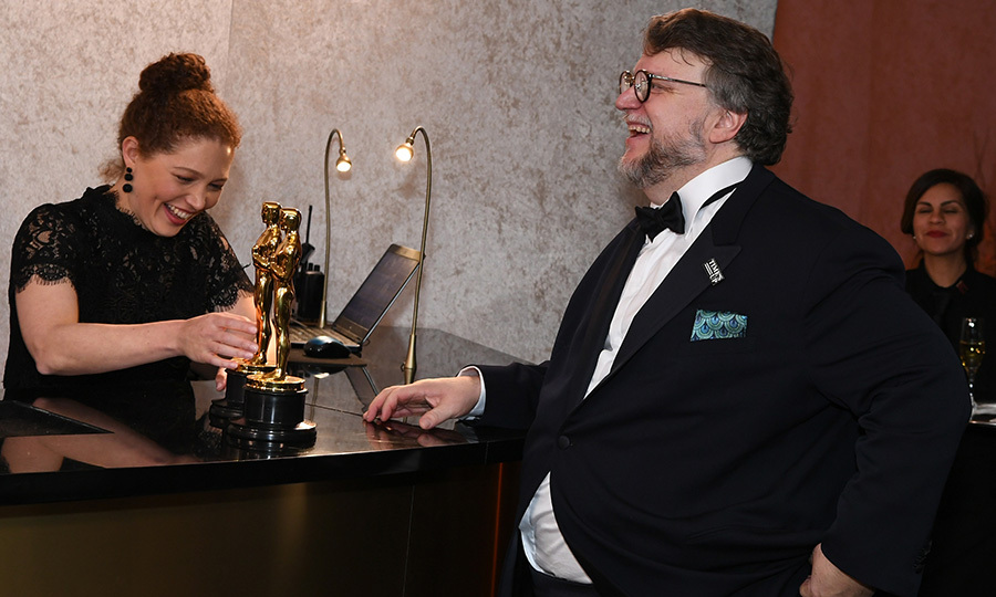 Best Director and Best Film winner Guillermo del Toro of <I>The Shape of Water</I> was in high spirits as he had his golden statuettes engraved. 