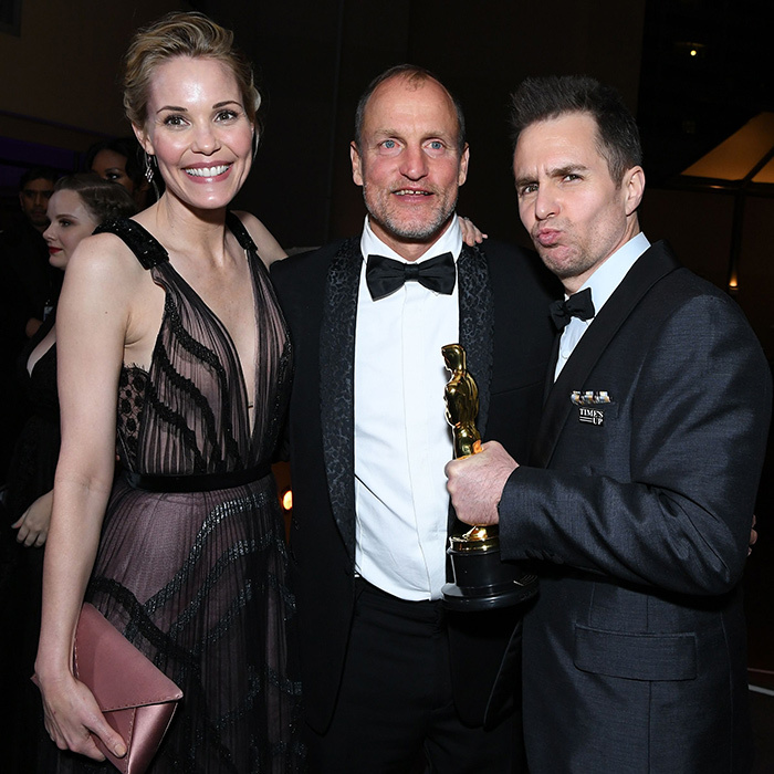 Sam Rockwell clutched his brand new Oscar as he joined longtime love Leslie Bibb and actor Woody Harrelson.