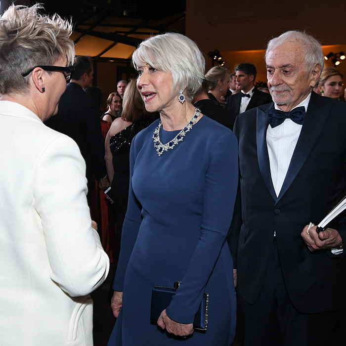 Dame Helen Mirren wore some very regal sapphires as she mingled at the 90th Annual Academy Awards Governors Ball.