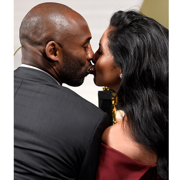Oscar winner and NBA star Kobe Bryant celebrated his best animated short win with a kiss for wife Vanessa Bryant.