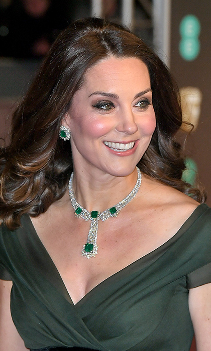 In February 2018, the Duke and Duchess of Cambridge stepped out for a glittering night at the British Oscars, the BAFTAs. The pregnant Duchess looked incredible in a forest green gown by one of her favorite designers, Jenny Packham. Eagle-eyed jewelry fans, however, were very excited by her choice of gems, including a jaw-dropping necklace and emerald earrings. The Duchess appeared to be making very good use of her stunning jewelry collection because it turns out her earrings are actually convertible! She last wore the emerald earrings in a drop style setting in December 2014 – see the next slide to see how they looked...
