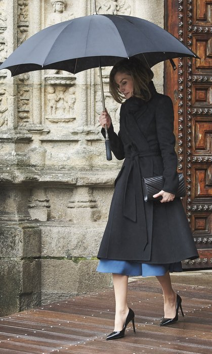 Queen Letizia of Spain showed us how to do rainy weather dressing in style in a wrap coat and patent leather heels at the Digitalizadas presentation at the Reyes Catolicos Hotel in Santiago de Compostela, Spain.