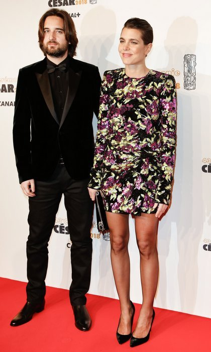 Monaco royal Charlotte Casiraghi, daughter of Princess Caroline, stepped out with boyfriend Dimitri Rassan at the Cesar Film Awards in Paris. Making her red carpet debut with her real-life leading man, Grace Kelly's granddaughter looked glamorous in a long-sleeved floral mini dress and sheer black stockings. 
