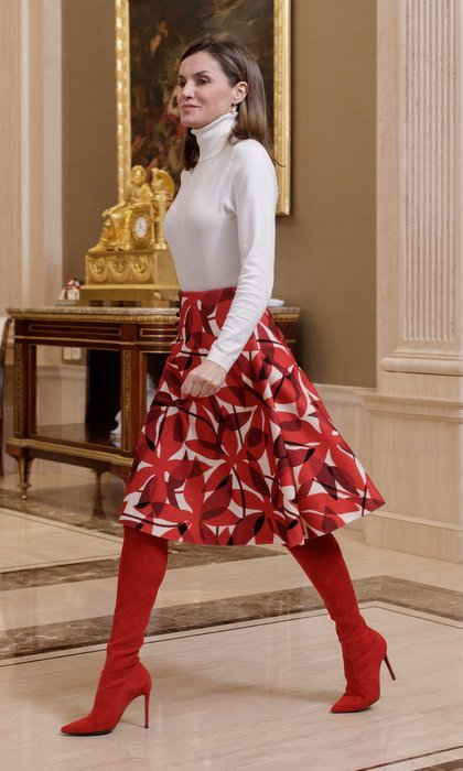 Queen Letizia of Spain was walking tall in her favorite red suede boots and a print skirt as she received the Spanish Winter Olympics Team at Madrid's Zarzuela Palace.