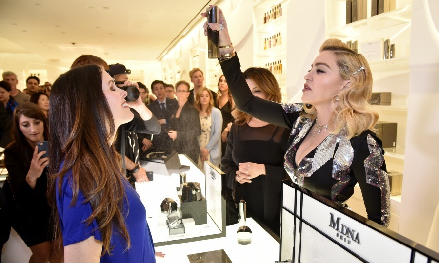 Here's a little spritz! Before her star chat with Kim, Madonna greeted fans at the MDNA SKIN Counter at Barneys New York in Beverly Hills on March 6.