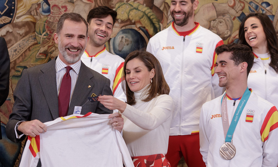 It was a day of celebration at Zarzuela Palace as King Felipe and Queen Letizia welcomed Spain's 2018 Winter Olympic team. The monarchs beamed as they proudly held up a signed jersey during the celebration, in honor of the team, which brought two bronze medals home to Spain.